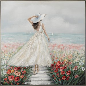 Woman in a sea of flowers in a white dress