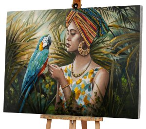 Lady in jungle with blue-coloured parrot