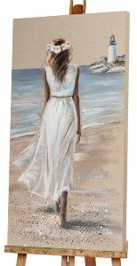 Femme à la plage avec robe blanche II