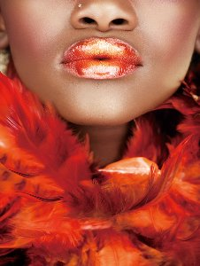 Beauty with red feather boa